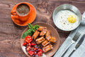 Baked eggs with sausage and vegetables in the pan. Royalty Free Stock Photo