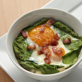 Baked Eggs and Spinach Stock Images