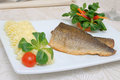 Baked fillet of sea bass with vegetables and mashed potato mix Stock Image