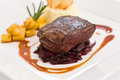 Baked fillet steak over braised cabbage Stock Image