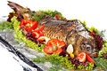 Baked fish decorated with vegetables and prepared for the banquet Royalty Free Stock Images