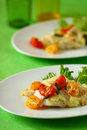 Baked fish fillet  with tomato Stock Photo