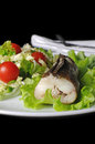 Baked fish king clip with vegetables a salad of green and cherry tomatoes Royalty Free Stock Photography