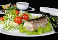 Baked fish king clip with vegetables a salad of green and cherry tomatoes Royalty Free Stock Photos