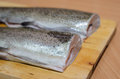 Baked fish rainbow trout stuffed on a cutting board wood Royalty Free Stock Photo