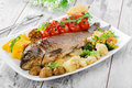 Baked fish with vegetables Royalty Free Stock Photo