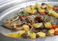 Baked flounder fish with potatoes, olives and tomates Royalty Free Stock Photo
