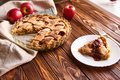 stock image of  Baked food : apple pie served with fresh apples on white plate on wooden table