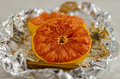 Baked grapefruit in alluminum foil paper Stock Photo
