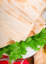 Baked lavash bread close up with salad Royalty Free Stock Photo