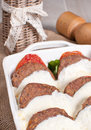Baked meat cutlets with melted cheese and tomato Stock Photos