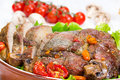 Baked meat grilled with vegetables in a ceramic bowl Royalty Free Stock Image