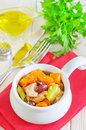 Baked meat with vegetables and greens Stock Image