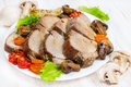 Baked meat with vegetables on a white plate Stock Images