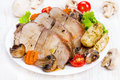 Baked meat with vegetables on a white plate Stock Image