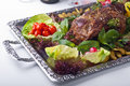 The baked mutton foot with vegetables Stock Images