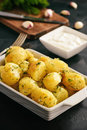 Baked new potatoes with garlic and dill. Royalty Free Stock Photo