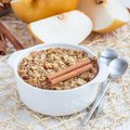Baked oatmeal with nuts, almond milk, honey, spices and asian pear, square format Royalty Free Stock Photo