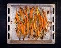 Baked organic carrots with thyme, honey and lemon. Organic vegan food.