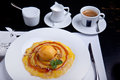 Baked pear with ice cream ball and coffe cup on a plate Royalty Free Stock Photography