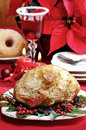 Baked pork with dried plums on christmas table Stock Image
