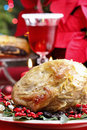 Baked pork with dried plums on christmas table Stock Photos