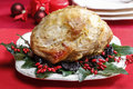 Baked pork with dried plums on christmas table Stock Photo