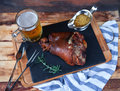 Baked pork shank, rosemary branch and honey sause and glass of b Royalty Free Stock Photo