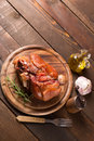 Baked pork shank on wooden table with free space for text Royalty Free Stock Image