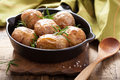 Baked potatoes in black pan Stock Photography