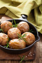 Baked potatoes in black pan a Stock Photos