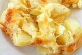 Baked potatoes with cheese Royalty Free Stock Photography