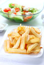 Baked potatoes with dip and vegetable salad Royalty Free Stock Photo