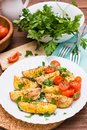 Baked potatoes with ripe tomatoes and fresh herbs Royalty Free Stock Photo
