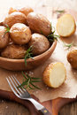 Baked potatoes with rosemary in a black pan Royalty Free Stock Photo
