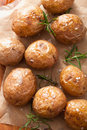 Baked potatoes and rosemary herb Stock Images