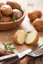 Baked potatoes and rosemary herb Royalty Free Stock Photo