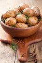 Baked potatoes in wooden bowl a Stock Photo