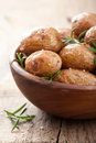 Baked potatoes in wooden bowl a Stock Image