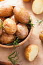Baked potatoes in wooden bowl Stock Photography