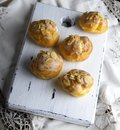Baked profiteroles with custard sprinkled with almonds