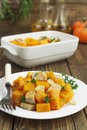 Baked pumpkin with chicken garlic and herbs on the plate Royalty Free Stock Photography