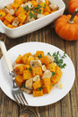 Baked pumpkin with chicken garlic and herbs on the plate Stock Photography
