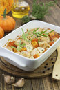 Baked pumpkin with chicken garlic and herbs in the pot Royalty Free Stock Photos