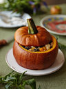 Baked Pumpkin with Rice and Fruits Stuffing Royalty Free Stock Photography