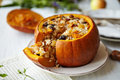 Baked Pumpkin with Rice and Fruits Stuffing Royalty Free Stock Photo
