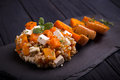 Baked pumpkin salad with feta cheese on black slate dish Royalty Free Stock Photo