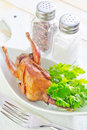Baked quail and parsley on white plate Royalty Free Stock Image