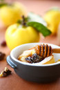 Baked quince with walnuts and honey in a baking dish Stock Photo