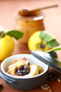 Baked quince with walnuts and honey in a baking dish Stock Images